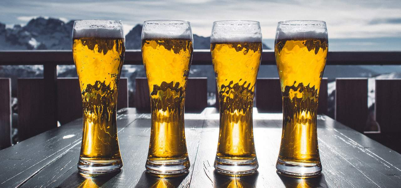 Line of beer glasses on a table