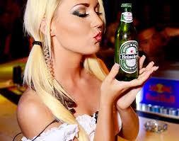 Bavarian girl kissing beer bottle