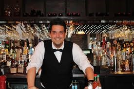 bartender leaning over bar counter