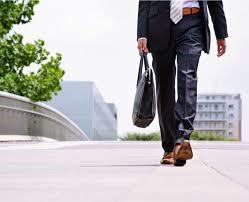 business man in suit walking on street