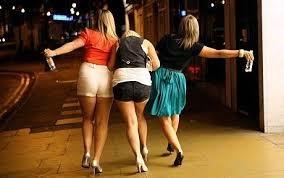 Drunks girls stumbling down the street