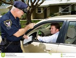 policeman giving out ticket