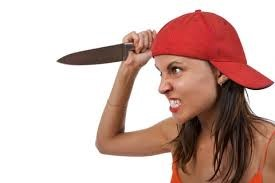 woman with knife looking like she wants to stab somebody